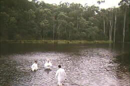 Evangelism tours in 1996, 1997 and 1998, reaching congregations across the continent in Melbourne, Dandedong, Brisbane, Perth, Sydney and Madagee. Baptizing in Lake Thompson, Australia